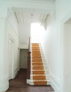 painted stair with bare wood runner
