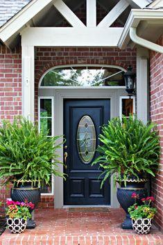 kimberly queen ferns, black urns, front porch