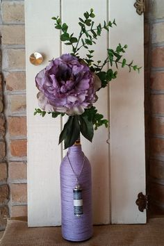 Purple cord wrapped wine bottle with a purple peony and unique silver embellishment, re-purposed wine bottle