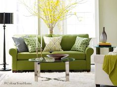 Pair rich Avocado green with printed pillows for your living room sofa set. It gives the room a bright summery feel all year long. #ColourYourHome #HomeDecor #Green #HomeStyle #Colours #Walls #Home