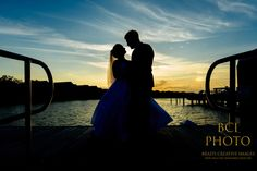 A dramatic silhoutte shot of our the bride and groom following their wedding ceremony at Harbour Ridge Yacht and Country Club in Pt St Lucie Florida.