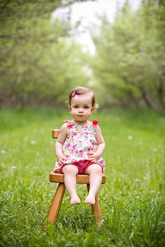 Baby girl on chair