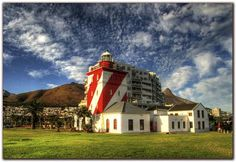 Beautiful photo of the Mouille Point Lighthouse in Cape Town, South Africa Cape Town Holidays, Point Light, Holiday Accommodation, South Africa, Places To Visit, Around The Worlds, Mansions, Lighthouses, House Styles