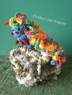 This bird, made for the art project Feathers and dragons is inspired by the wonderful colourful world of Julia, from Dada Neon Crochet. Dragon Bird, Feathers, Dragons, Art Projects, Birds, Neon, Christmas Ornaments, Inspired, Holiday Decor