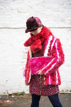 Susie Bubble in House of Holland cap, scarf and clutch bag, Body Editions top, Kenzo skirt, Pollini shoes