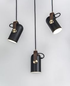Klint Carronade Lights | From Le Klint, the made-in-Denmark Carronade series  just now available in stores. It includes pendant lights, desk and floor lamps, and wall lights.