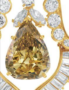 The Burton Cognac Diamond Earrings. Van Cleef & Arpels, 1974.   Elizabeth Taylor Collection, Christie's. Close up shot of the Earring