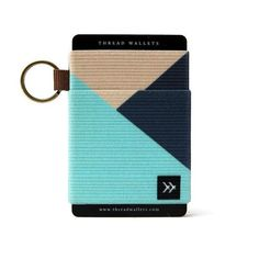 An elastic credit card holder designed for the fashionable minimalist. As a fashion accessory, we believe wallets should let you express your unique personality. Thread Wallets, Credit Card Design, Cloth Bags, Aqua Blue, Fashion Accessories, Card Holder, Beige, Personality, Minimalist