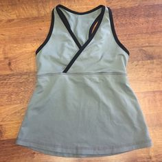 Lululemon tank Lululemon tank size 8. It's an older style so it looks smaller than an 8 but it says 8 on the inside! Has built in bra. Good condition! lululemon athletica Tops