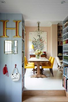 Kitchen storage wall between the kitchen & open plan living room-dining room to make this small flat feel bigger. Small space furniture, storage, kitchen ideas.