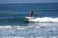 Sliding, SUP style.  The 9' Siren Sojourn SUP surfs as well as it SUPs.