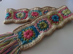 A winter scarf in spring colors...using the puff flowers. (crochet pattern)