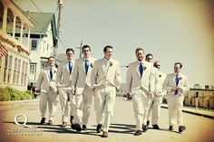 shot of groomsmen walking
