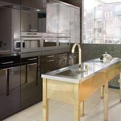 Brass kitchen island designed by Candi Kitchens