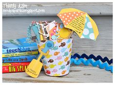 Ohhh so cute! Fun favor filled w/treats for a pool party or beach party. Could also use the idea for the invitation by making the pail-shaped card