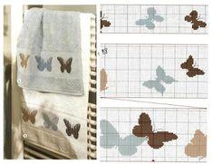 Ricamo con farfalla a punto croce per asciugamano