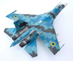 The Su-27 from Academy. Detailed with Aires cockpit, wheel wells and exhaust nozzles, Eduard photo-etch, missiles and wheels, Wolfpack front wheel well, Quickboost nose and antennas, Dream Model pitot tube and photo-etch.