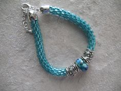 Aqua beaded bracelet with kumihimo braid Miyuki by AquaLunaCreate, $40.00