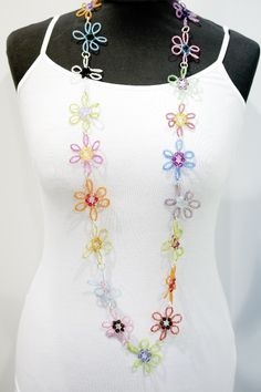 Swarovski Flower Chain Tute. Seed beads, crystals, beading wire and crimps.  #Beading #Jewelry #Tutorial