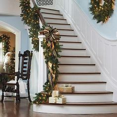 ღღ A lush, well-lit garland draped from the bannister beckons guests inside. - Photo: Courtesy of Frontgate