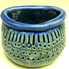 Transparent blue glaze on a pinch pot. Like the single coil attatched to make the rim!