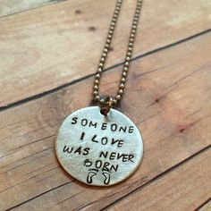"""Miscarriage Necklace Reads """"Someone I Love Was Never Born"""" with Footprints on a Ball Chain Necklace"""