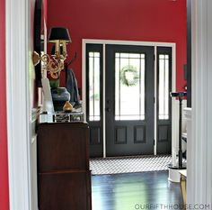 Reverse the wall and door colours, with the same red on the dresser and inside cabinet