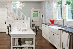 kitchen-white cabinets, gray countertops, farm sink