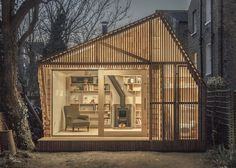 Light glows through the cedar facade of Writer's Shed by WSD