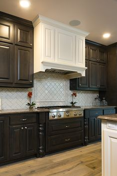 Backsplash: Highland Park color Antique White in 3x6, 2x6 crown and arabesque shape; Hardwood: Provenza Pompeii color Ustica
