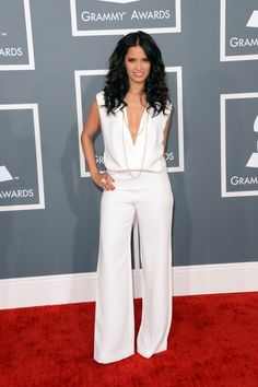 Rocsi Diaz reps for ET in a white hot jumpsuit!