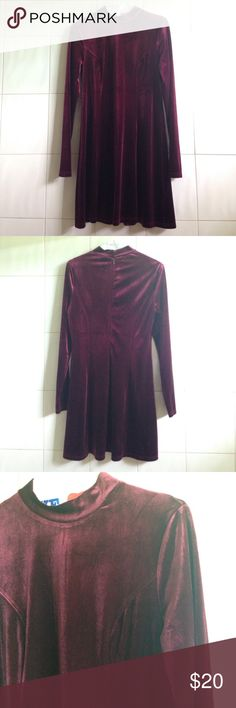 "Burgundy velvet dress Burgundy velvet dress, flowy skater skirt, long sleeve, short turtleneck, 92% polyester, 7% spandex. Wine or maroon. Laying flat: shoulder to shoulder 14"", shoulder to bottom 32"", sleeve length 25"", mock neck 1.5"". Barely worn, great condition. Make an offer or bundle and save. Forever 21 Dresses Long Sleeve"