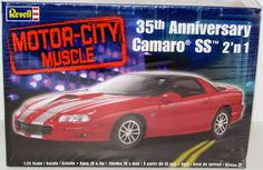 This 2002 Chevy Camaro 35th Anniversary kit is made by Revell in 1/25 scale. - SS body with special hood and SS rear spoiler - Stock and Custom wheels with low profile tires - 35th Anniversary stripin