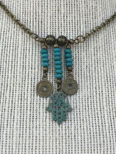 A personal favorite from my Etsy shop https://www.etsy.com/listing/507335819/hamsa-lucky-coin-necklace