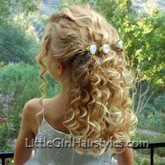 Planning this style of hair for Aurora when she's a flowergirl. I have crystal flower clips to replace those rosettes.