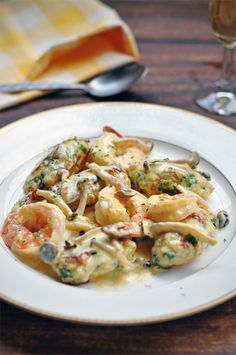 Spinach and Ricotta Dumplings with Prawns and Mushrooms in Cream Reduction.