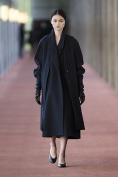 2. Long vest and maxi coat in wool melton, gloves in wool melton and leather, straped slippers in calf leather  #lemaire