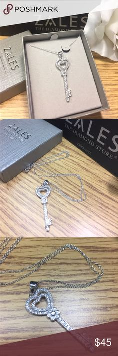 NWB Zales Wht Sapphire/ Sterling Silver Necklace New with box. Zales lab-created white sapphire with ❤️heart-top key  pendant in sterling silver. 18' cable chain with a spring ring clasp. Zales Jewelry Necklaces