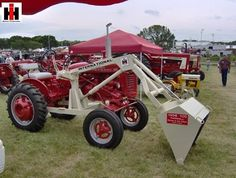 tractors.Nice looking Farmall Cub with white loader
