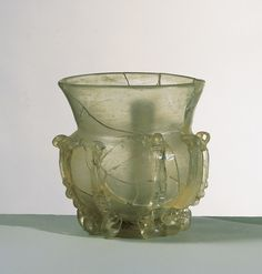Oil lamp, yellowish glass with applied threads Iran or Central Asia; 10th-11th century H: 12.5; Diam: 12 cm