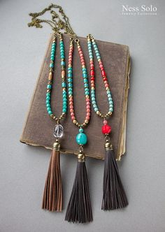 Long beaded boho necklace with red coral and Czech glass beads, a coral pendant and a genuine leather tassel. The necklace measures 34 1/2 inches (88 cm) with a 5 inches (12,5 cm) stone and tassel drop. Let me know if you need another length. I only use genuine leather tassels with