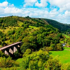 The Monsal Trail on the Headstone Viaduct from Monsal Head in the Peak District National Park  #bridge #britain #district #england #head #headstone #landscape #monsal #national #nature #outdoors #park #peak #river #scenic #sky #trail #trees #uk #valley #viaduct #water #wye