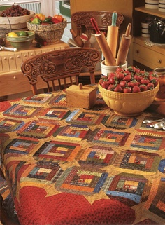 Simple Blessings tablecloth by Kim Deihl...I actually love how they are displaying the roller pins in the ceramic vase :)