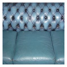 Shabby blue leather chesterfield couch.  Photo by Sam Egarr