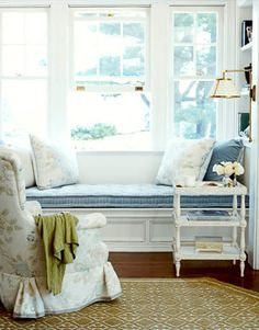 Create a Cozy Reading Nook?  I am not sure if I should do this with the front window, or if I should use the window seat as part of an eating nook?