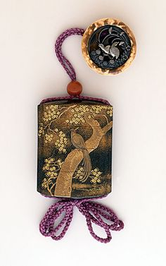 Kajikawa School (Japan, died N/A)   Inro, Ojime, late 18th-early 19th century  Costume/clothing accessory/waistwear, Three-case inro with bird in tree in gold takamakie and kirigane with aogai on mura-nashiji ground; coral bead ojime