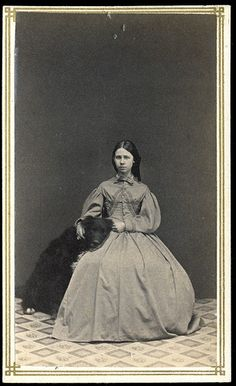 CDV of a seated woman with large black dog  by J.P. Vail via George Eastman House, via Flickr
