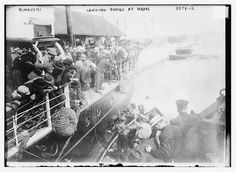 Bain News Service,, publisher.  Rimouski -- landing bodies at wharf  [May 1914]  1 negative : glass ; 5 x 7 in. or smaller.  Notes:  Title from data provided by the Bain News Service on the negative. Photograph shows bodies being brought to Rimouski, Quebec, Canada from the RMS Empress of Ireland which sank on the Saint Lawrence River, May 29, 1914. (Source: Flickr Commons project, 2011 and New York Times, June 1, 1914) Forms part of: George Grantham Bain Collection (Library of Congress)…