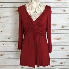 "Deep Red Twist Front 3/4 sleeve top This is a great top that flatters your curves! Brand new, never worn. Size Large. 30"" length, 3/4 sleeve. Venus Tops"