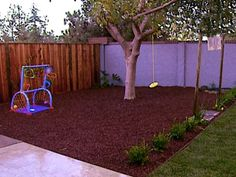 This play area features kid-friendly rubber mulch that looks like redwood. From the experts at DIYNetwork.com.